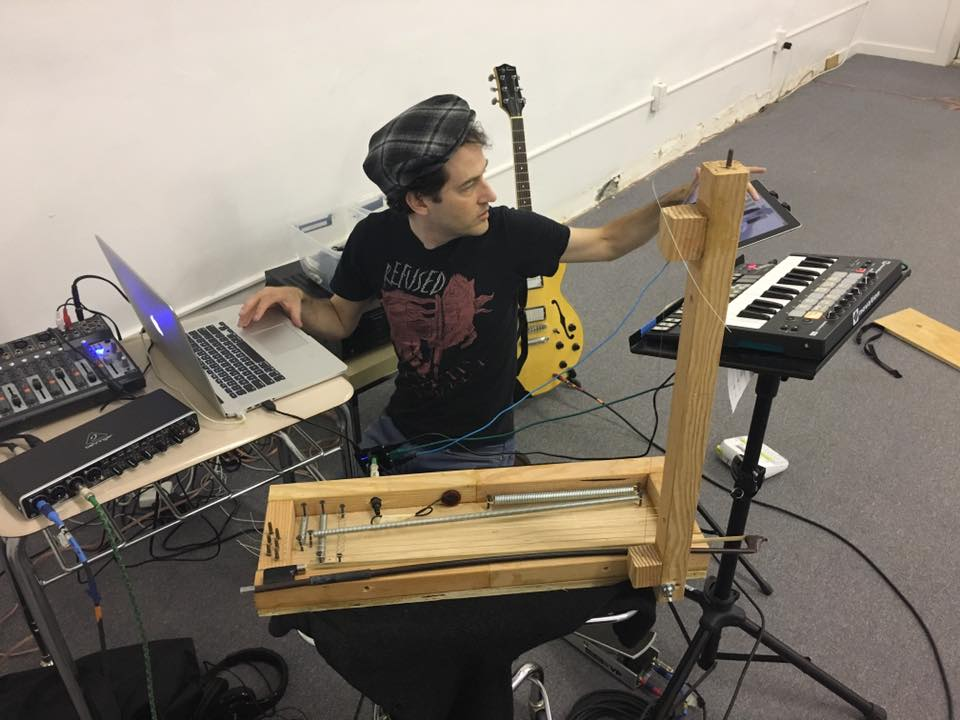Joshua Kohl of Degenerate Art Ensemble sets up for Skeleton Flower, 2017.