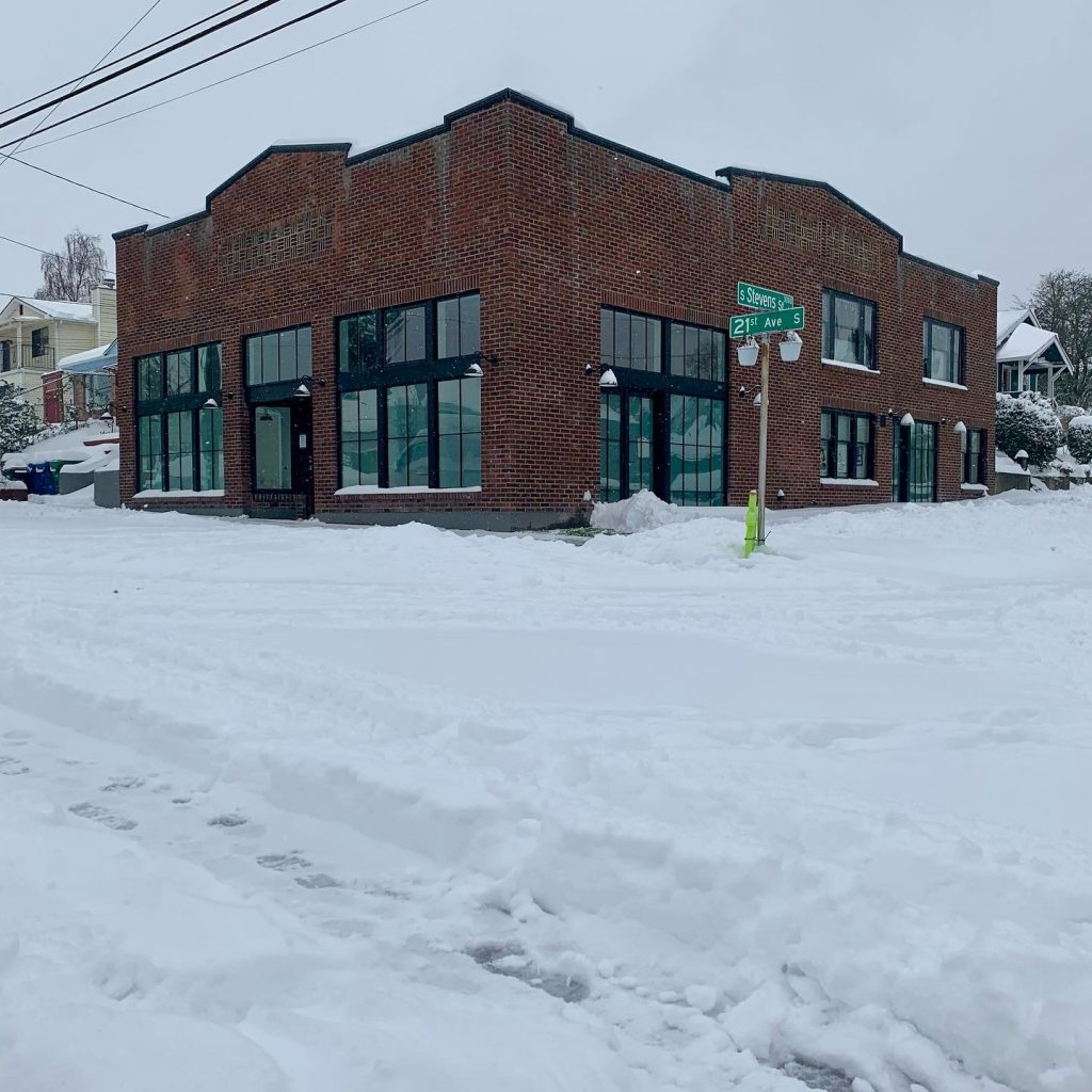 Street view of The Grocery exterior, in the snow.
